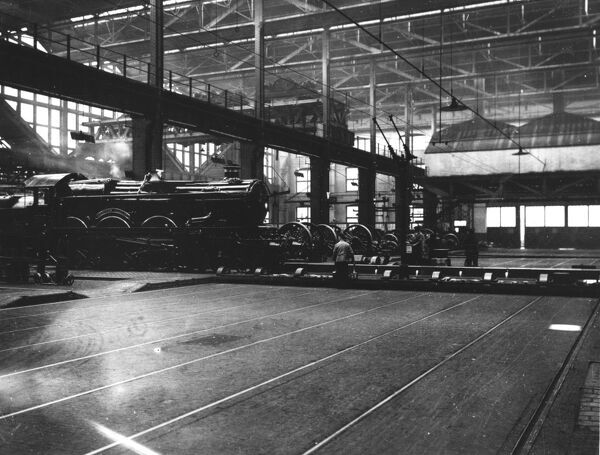 4-6-0 Castle class locomotive. Built 1936. Seen here moving onto traverser in 'A' Erecting Shop, Swindon Works