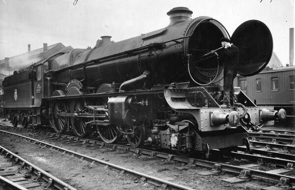 4-6-0 King class locomotive. Built 1928. Seen here at Swindon Shed being tube cleaned with a steam lance