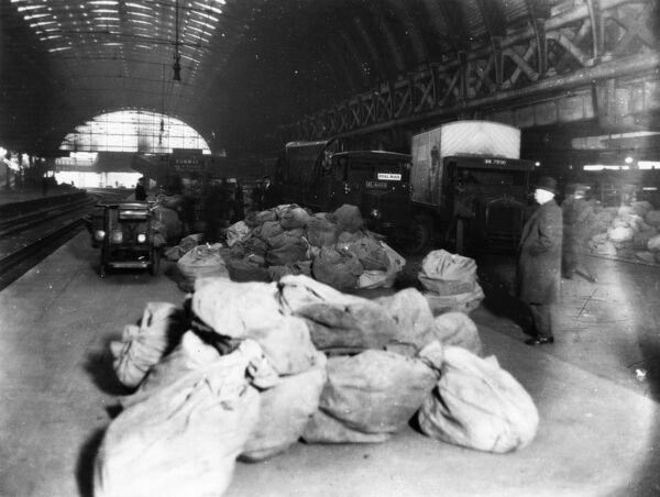 Mail sacks being loaded onto Royal Mail vans during the Christmas period of 1926