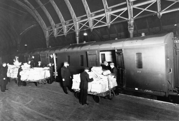 Staff on Platform 4 receive the daily newspapers from the 12.50am Newspaper Train