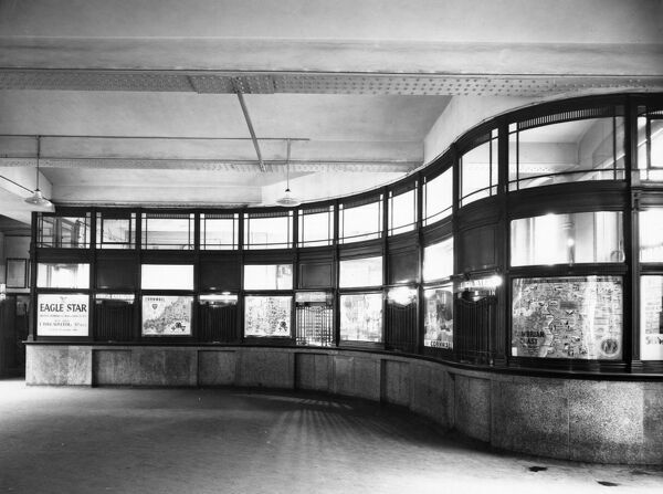 This image was taken in 1936 after extensive modernistation was made to the Station. This ticket office in No.2 Booking Hall displays various holiday posters