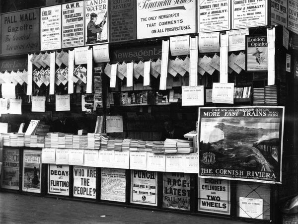 This bookstall is cramed full of books, leaflets and posters. GWR publicity can clearly been seen in this image