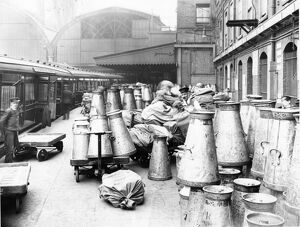 Empty milk churns on Paddington Station c1914