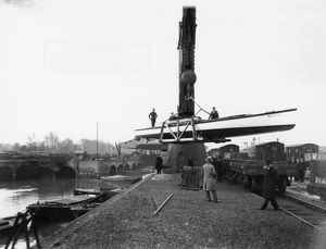 Transferring a boat from river to rail at the GWR Brent Docks, c1930s