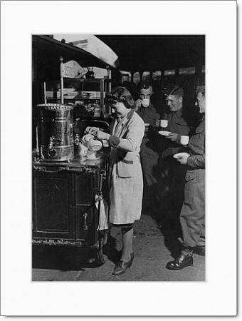 Servicemen drinking tea from a refreshment trolley on Paddington station, during WWII