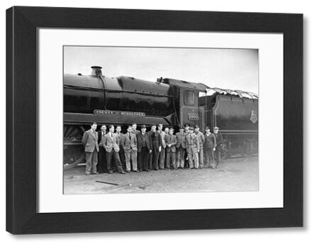 GWR 4-6-0 locomotive number 1000 County of Middlesex with a group of staff. Built 1945, withdrawn 1964