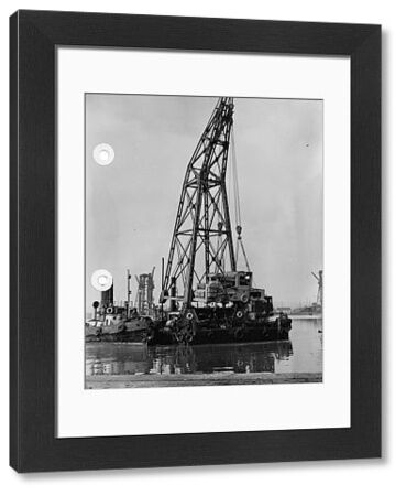 "100 ton floating crane, Simson III, with an ingot buggy from SS Stonegate. Steam tug ""Trusty"" can be seen to the left of the crane and steam tug ""Gwent"" to the right"