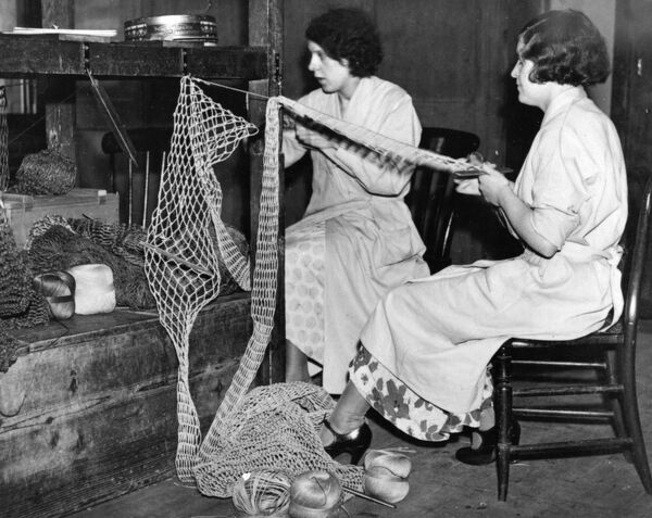 Female staff weaving luggage racks