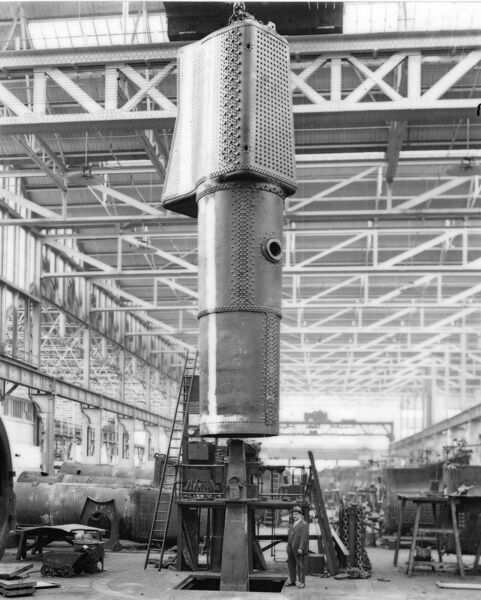 Boiler suspended vertically from crane