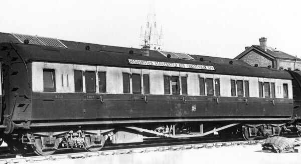 A view of First Class passenger carriage No. 8013, built in October 1925. The destination board for Paddington, Gloucester and Cheltenham Spa is on the roof