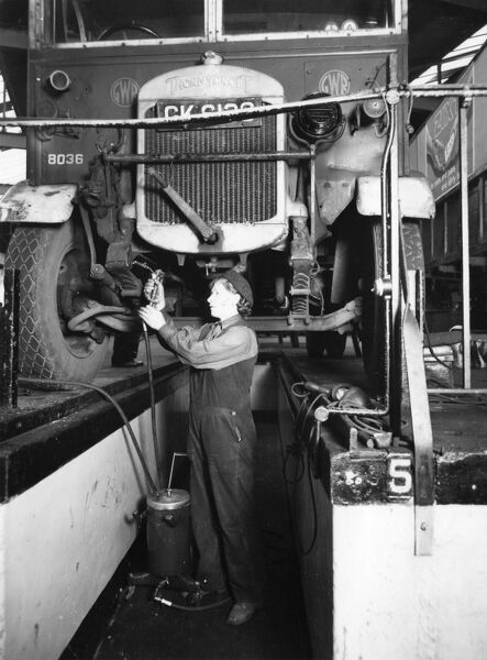Female worker servicing a Thorncroft lorry at Slough Road Vehicle Works, 1944