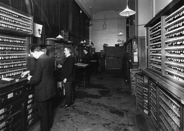This interior shot of the Ticket Office at Paddington Station was taken in 1913. The ticket staff operated individual hatches