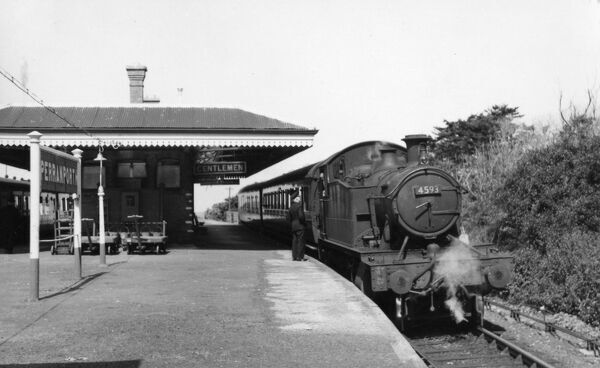 Locomotive No 4593 stands at Perranporth Station on 23rd April 1960 while the driver chats to a member of station staff before continuing on its journey to Newquay. The island platform sits between two running lines on the Truro to Newquay railway