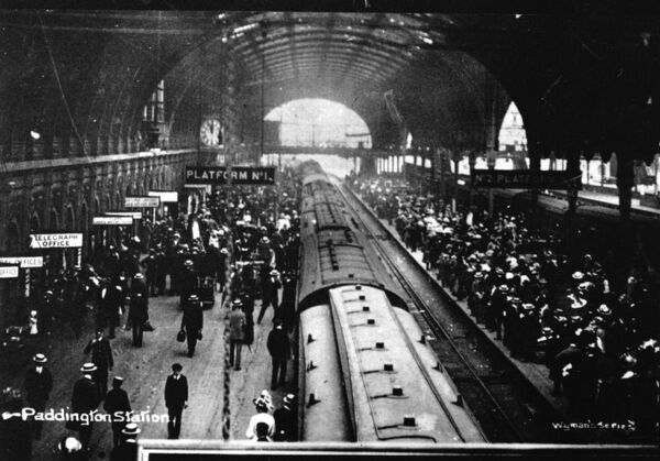 A classic Edwardian view of Platform 1 at Paddington Station. The crowds suggest it is the summer holiday season