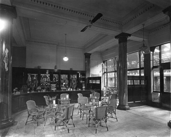 This glamourous shot shows the interior of the Refreshment Rooms, situated on Platform 1. The marble columns, silverware and wicker chairs made dining here a very enjoyable experience