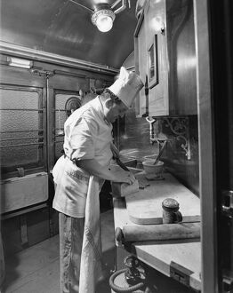 Chef preparing food in the Restaurant Car kitchen, 1946
