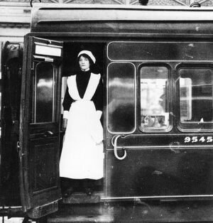 Female stewardess at the door of dining car No. 9545, 1917