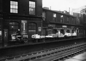 GWR Tractor and trollies on Paddington Station, c1936