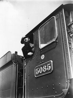 Locomotive driver in air raid kit, during WWII