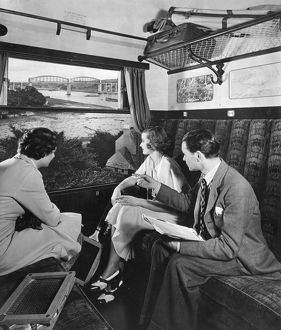 Publicity shot of passengers in carriage, 1930s