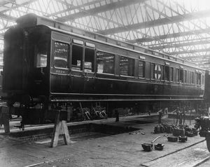 Wartime ambulance carriage awaiting repair in No 19 (C) Shop, 1915