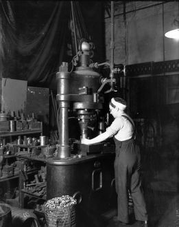 Woman using steam press at Swindon Works, 1942